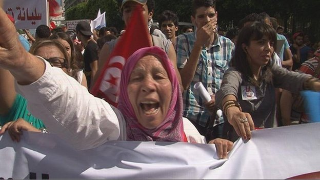 A woman gestures during an anti-government demonstration in Tunisian capital, Tunis.