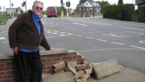 Barry Tice with his damaged wall