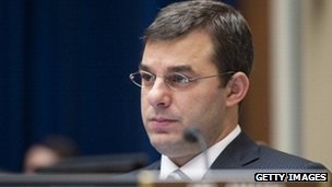 Representative Justin Amash listens during a congressional committee hearing.