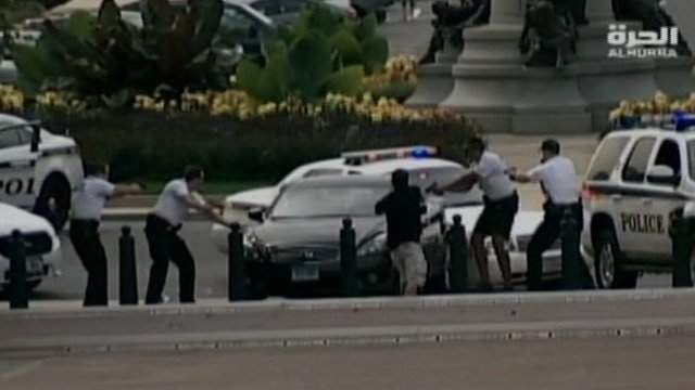Officers surround a suspect's car
