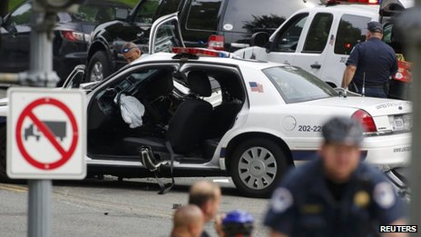 A damaged police vehicle was seen following reports of a shooting on Constitution Avenue near the US Capitol