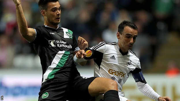 Leon Britton (right) in action against St Gallen's Goran Karanovic