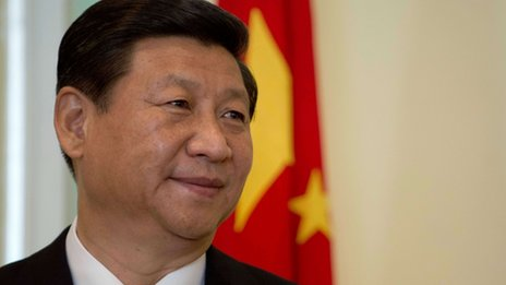 China's President Xi Jinping smiles during a joint press conference at the prime minister's office in Malaysia's administrative capital Putrajaya on 4 October 2013