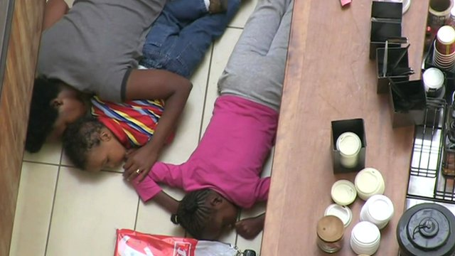 Faith Wambua with her daughter Sy and son Ty lying on floor during Nairobi siege