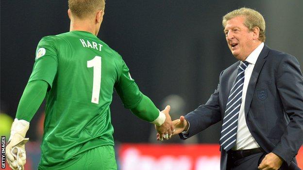 Roy Hodgson shakes Joe Hart's hand