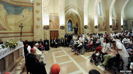 Pope Francis attends a meeting with disabled persons during his visit at the Serafico Institute in Assisi on 4 October 2013.