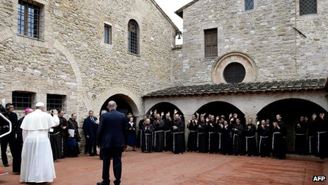 Pope Francis (L) visits the San Damian monastery on 4 October 2013 near Assisi.