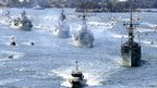 Royal Australian Navy warships led by HMAS Sydney (R) enter Sydney Harbour