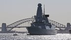 "Britian""s warships HMS Daring anchors in front of the Harbor Bridge during the International Fleet review in Sydney, Australia, Friday"