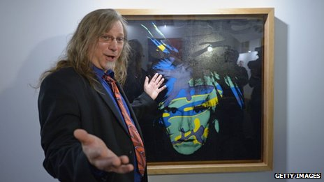 Matt Wrbican, Chief Archivist at The Andy Warhol Museum with one of the artist's self portraits