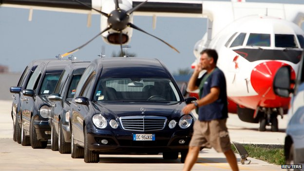 Hearses at Lampedusa's airport on 4 October 2013