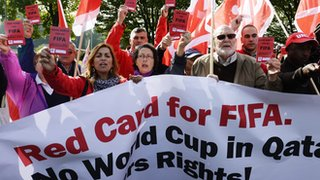 Trade unionists demonstrate in front of Fifa headquarters against the working conditions for the 2022 World Cup in Qatar,