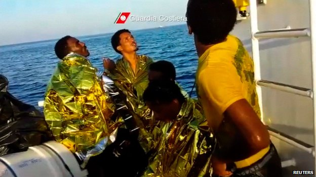 Rescued migrants in image released by Italian coastguard on 3 October 2013