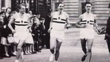 L-R Chris Brasher, Roger Bannister (with baton) and Chris Chataway at Buckingham Palace.