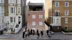 Artist Alex Chinneck's sliding house in Margate