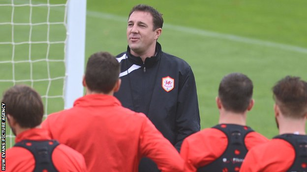 Cardiff City manager Malky Mackay talks to his players during a training session