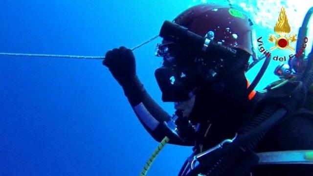 A diver searches for survivors