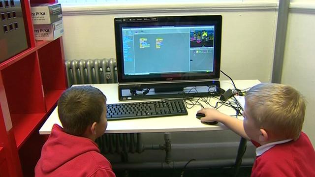 School pupils at at computer
