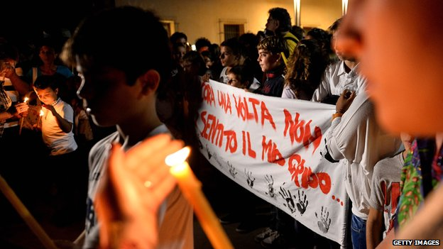 Torchlight procession through Lampedusa on 4 October 2013