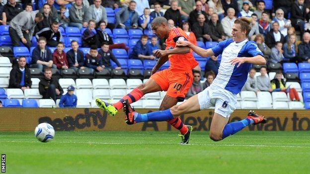 Bolton striker Jermaine Beckford (left) puts his side ahead against Birmingham