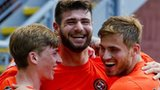 Ryan Gauld, Nadir Ciftci and David Goodwillie celebrate Dundee United's goal.