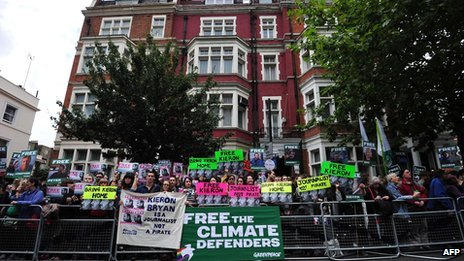 Greenpeace campaigners protest outside the Russian embassy in London on 5 October 2013