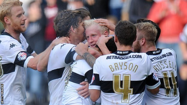 Derby's players crowd around Will Hughes after the midfielder's late strike seals victory over Leeds United