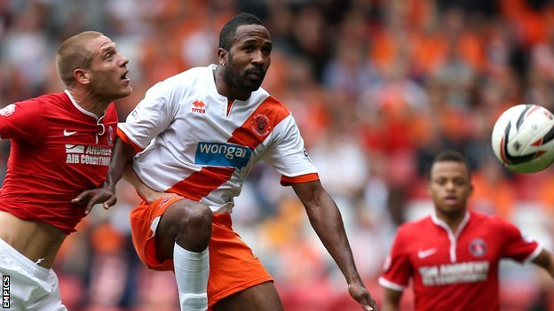 Blackpool's Ricardo Fuller (centre) in action against Charlton