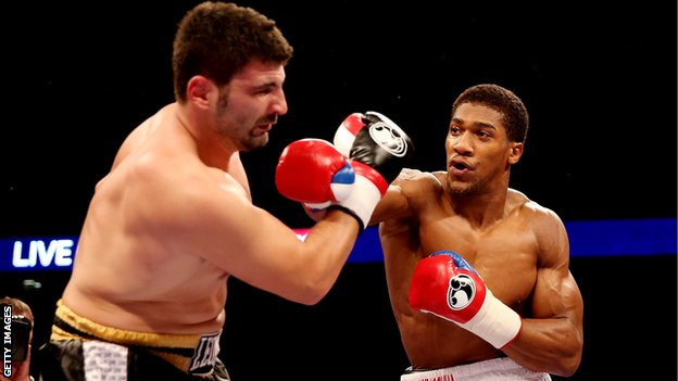 Anthony Joshua on his way to a first-round stoppage of Emanuele Leo