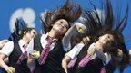 Cheerleaders perform at the China Open tennis tournament in Beijing.