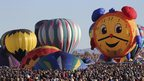 Crowds and balloons at the 42nd Albuquerque International Balloon Fiesta.