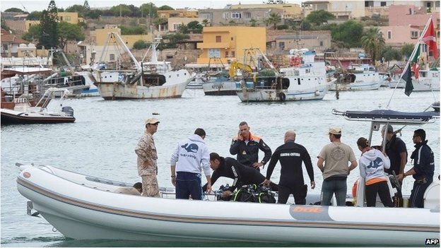 A team of divers with coast guards  members leaves the Lampedusa harbour heading for the sunken boat on 6 October.