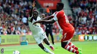 Southampton's Victor Wanyama tackles Swansea's Nathan Dyer