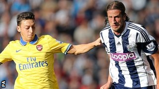 West Brom's Jonas Olsson and Arsenal's Mesut Ozil