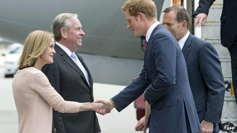 Prince Harry is greeted by West Australian Premier Colin Barnett and his wife Lyn Barnett at Perth Airport on 6 October 2013