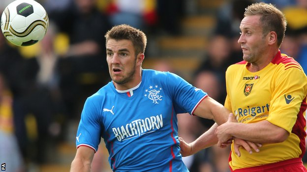 Andy Little holds off Albion Rovers opponent Ciaran Donnelly
