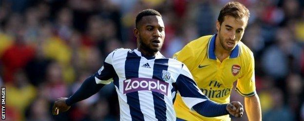Arsenal midfielder Mathieu Flamini tracks Stephane Sessegnon of West Brom