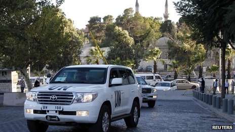 U.N. vehicles transporting a team of experts from the Organisation for the Prohibition of Chemical Weapons are pictured as they return to their hotel in Damascus October 3, 2013