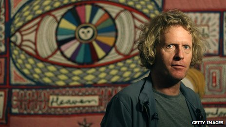 Grayson Perry stands in front of his tapestry 'Map of Truths and Beliefs' at The Tomb of the Unknown Craftsman exhibition at the British Museum (File photo)