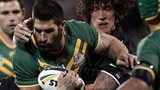 New Zealand's Kevin Proctor (second right) tackles Australia's James Tamou