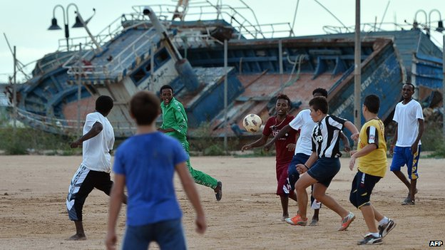 Eritrean and Italian children play football in Lampedusa, Italy, on 6 October 2013