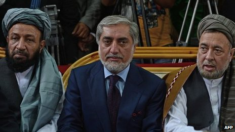 Afghan politician, Abdullah Abdullah (C) sits with his two vice-presidential candidates, Mohammed Mohaqiq (R) and Mohammad Khan (L) during a registration process for the forthcoming presidential elections at Independent Election Commission (IEC) in Kabul on October 1, 2013.