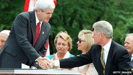 US Speaker of the House Newt Gingrich shakes hands with US President Bill Clinton