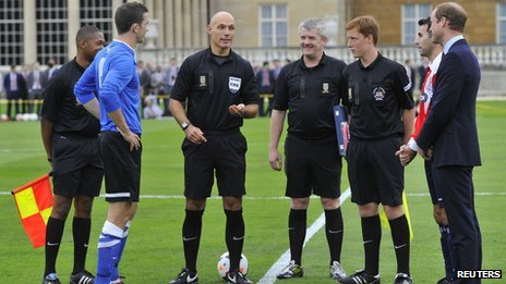 Referee Howard Webb tosses the coin before the match