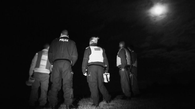 Police at night near badger cull protesters