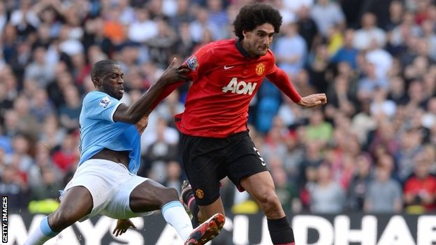 Manchester City's Yaya Toure and Manchester United's Marouane Fellaini