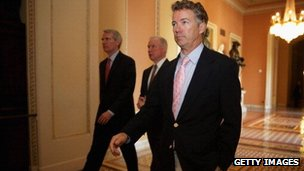 Senator Rand Paul walks to a meeting in the US Capitol.