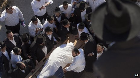 Ultra-Orthodox Jews carry the body of Rabbi Ovadia Yosef during his funeral procession in Jerusalem