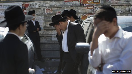 Jewish mourners observe the funeral of Rabbi Ovadia Yosef