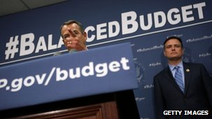 Congressman Luke Messer stands behind House Speaker John Boehner on Capitol Hill on 10 April 2013